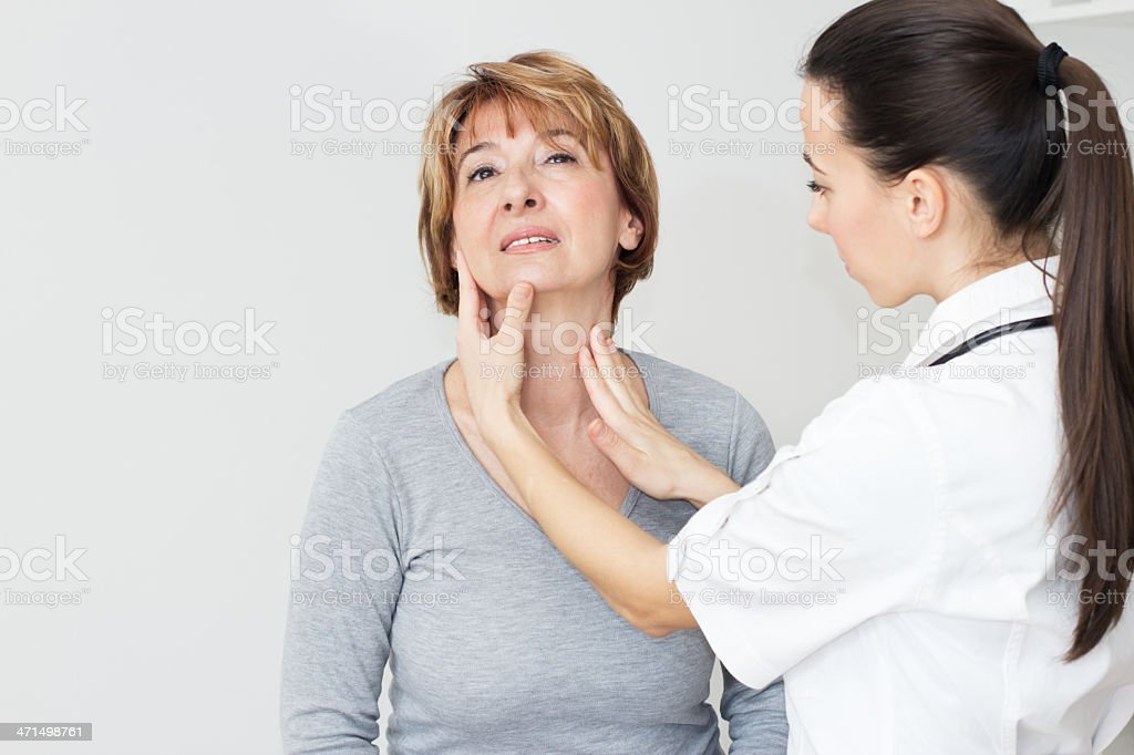 Young female doctor examining her patient stock photo
