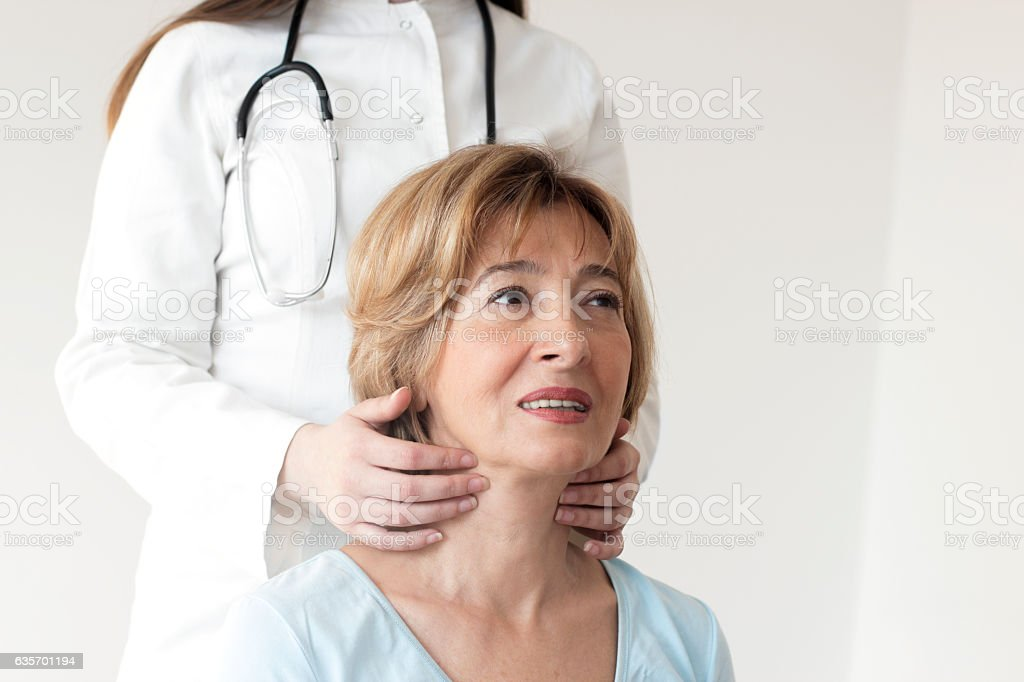 Young female doctor examining patient stock photo