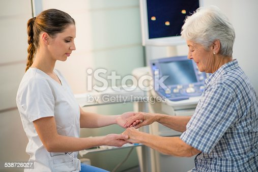 istock Young Female Doctor Holding a Senior Woman's Hands 538726027