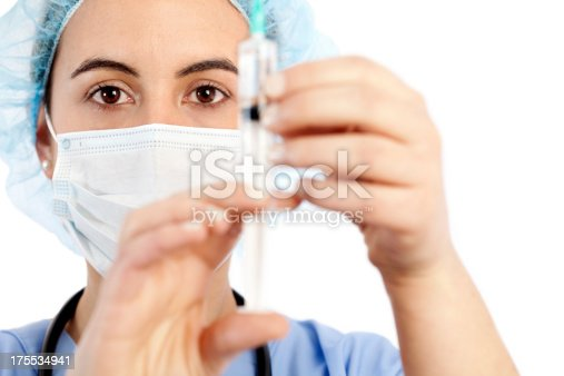 istock Young female doctor holding a syringe 175534941