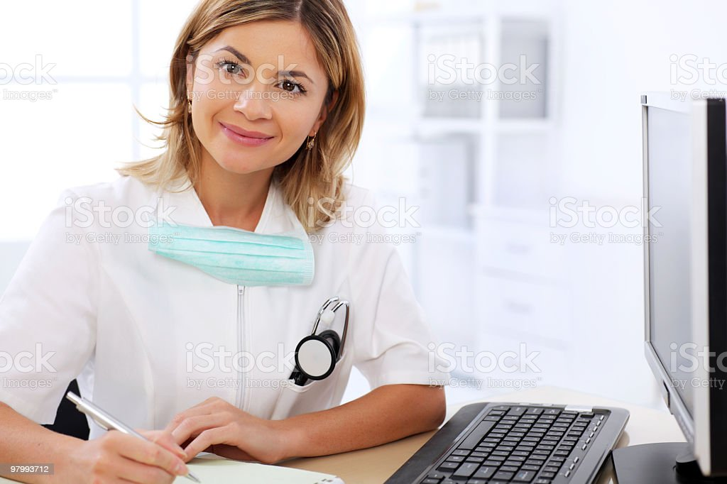 Young female doctor looking at camera in the office. royalty free stockfoto