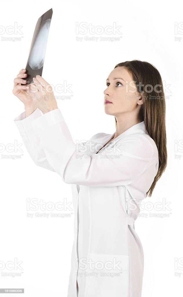 Young female doctor looking at the x-ray picture royalty-free stock photo