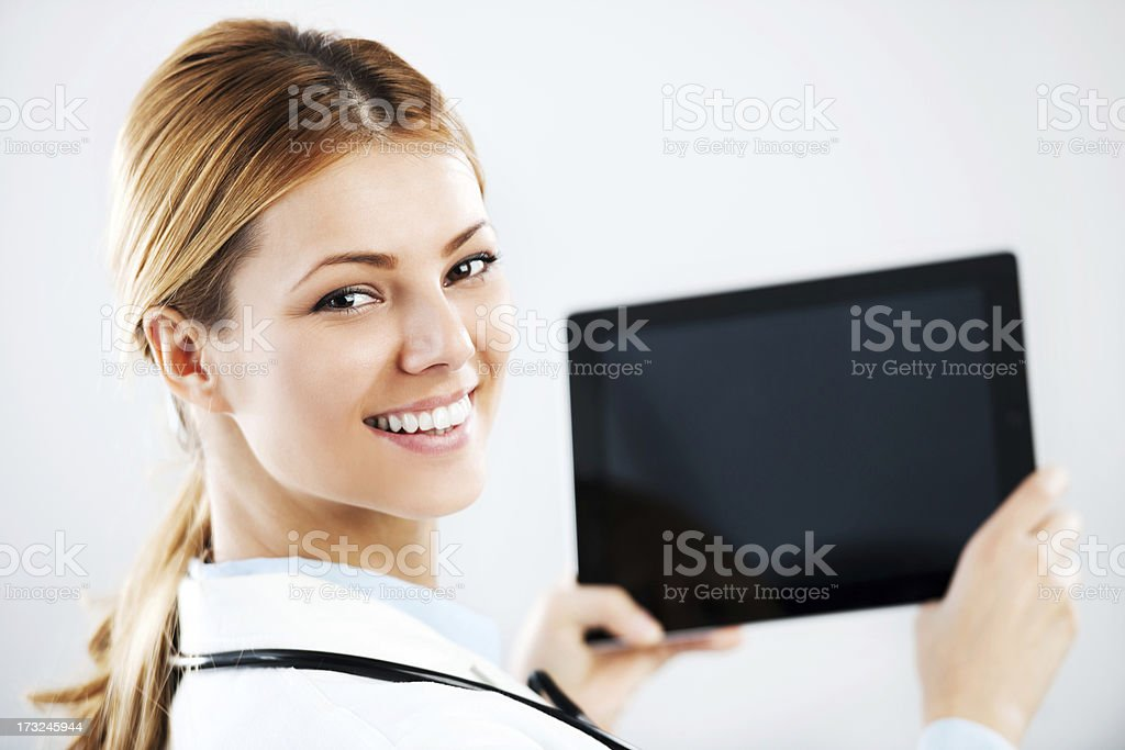 Young female doctor with digital tablet pc. royalty-free stock photo