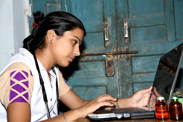 Young Female Doctor Working on Laptop stock photo