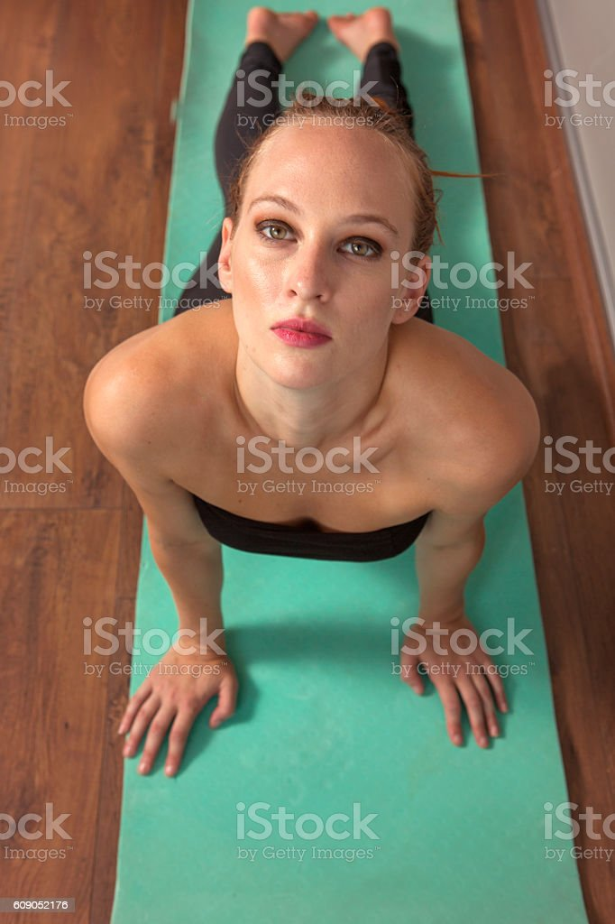 Young female doing physical relaxation exercise in istanbul turkey stock photo