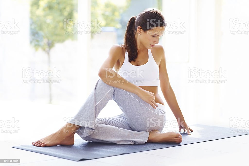 Young female doing yoga exercise stock photo