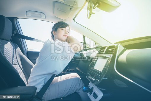 istock young female driver sleeping in vehicle. 861086722