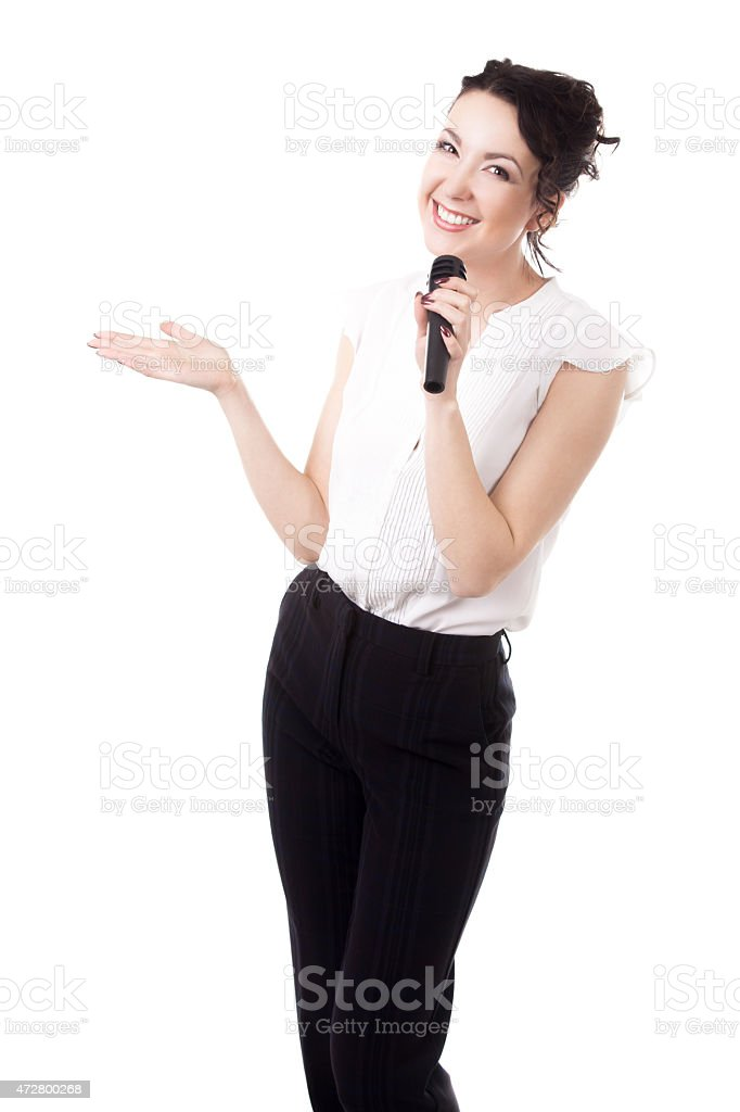 Young female emcee with microphone on white background stock photo