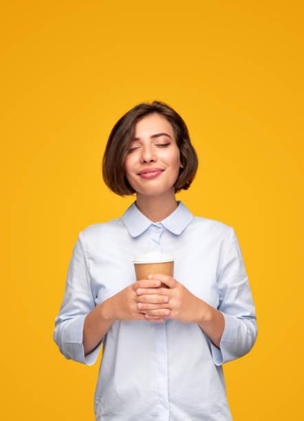 Young female enjoying coffee in morning stock photo