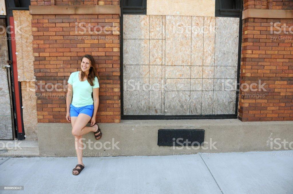Young Female Entrepreneur Engaging in Urban Renewal stock photo