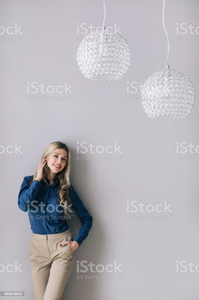 Young female executive standing. - Royalty-free Adult Stock Photo