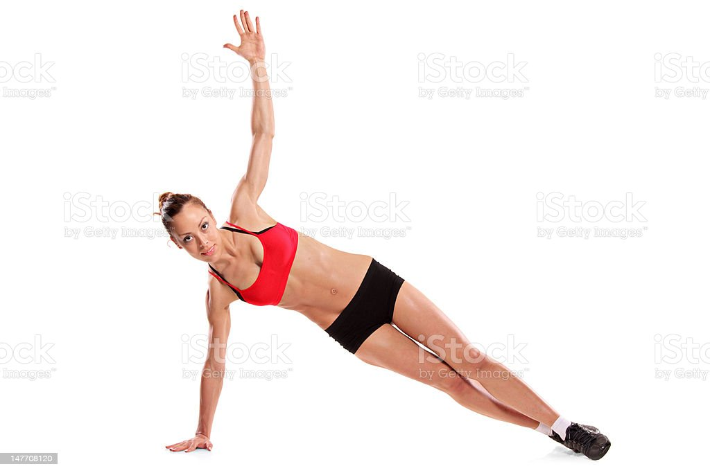 Young female exercising isolated on white background royalty-free stock photo