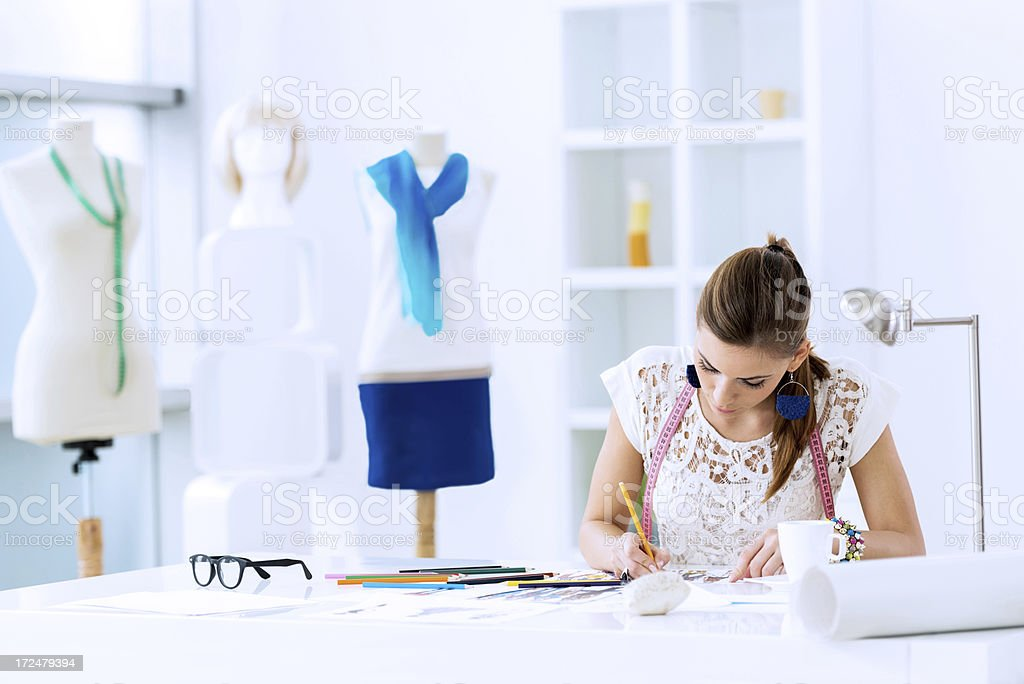 Young female fashion designer sketching. stock photo