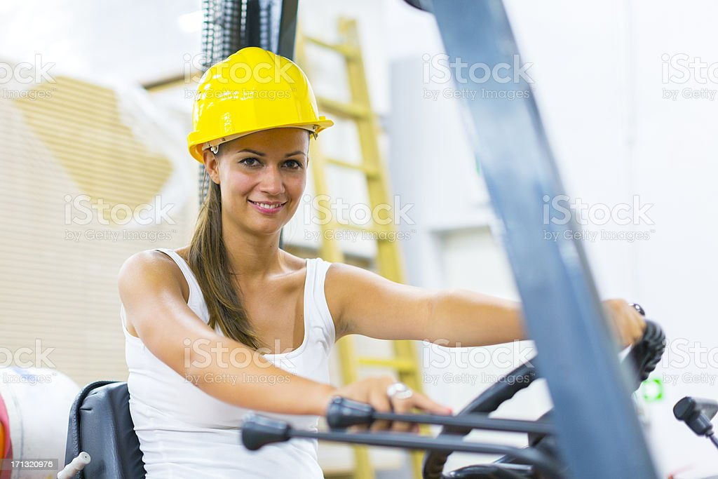 Young female forklift driver stock photo