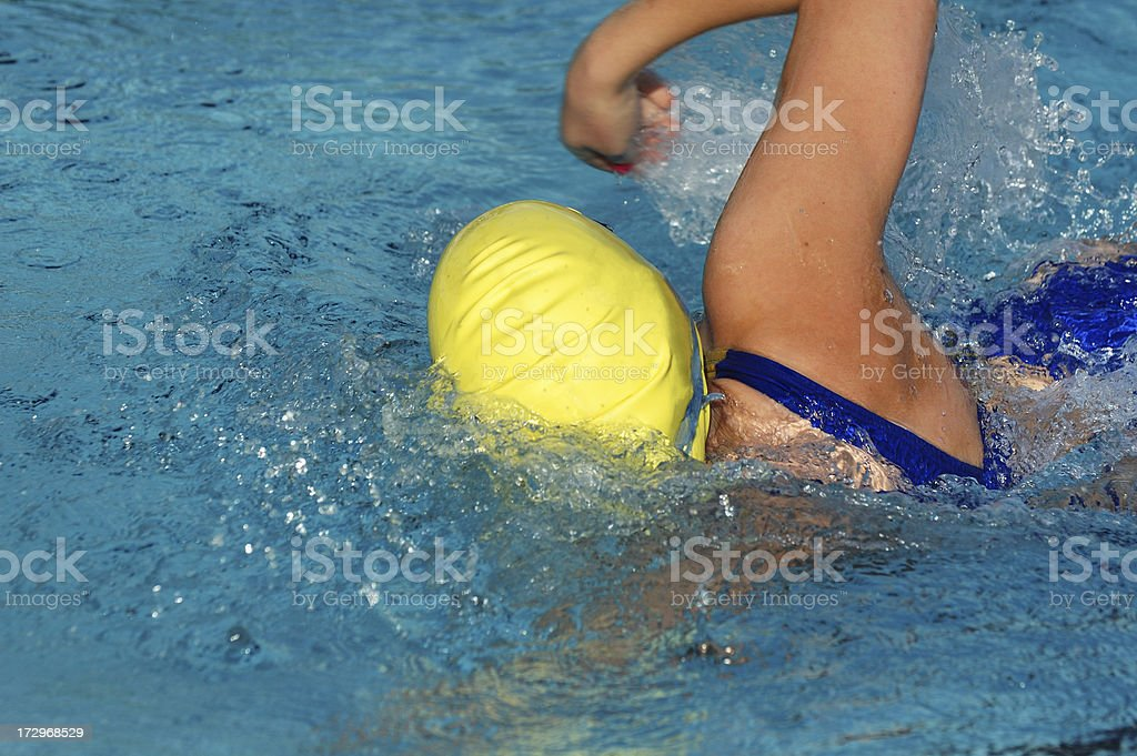 Young Female Freestyle Swimmer in Action stock photo