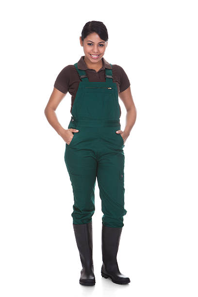 Young Female Gardner Young Female Gardner Isolated Over White Background bib overalls stock pictures, royalty-free photos & images