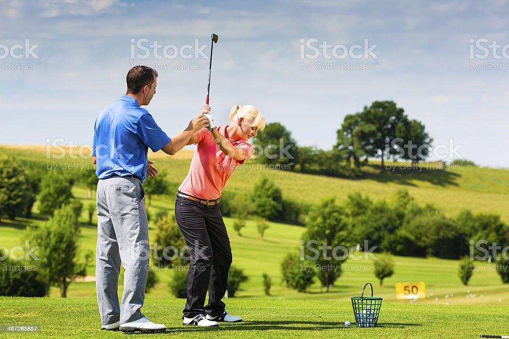Female Golfer On Golf Course Stock Image - Image: 16304405