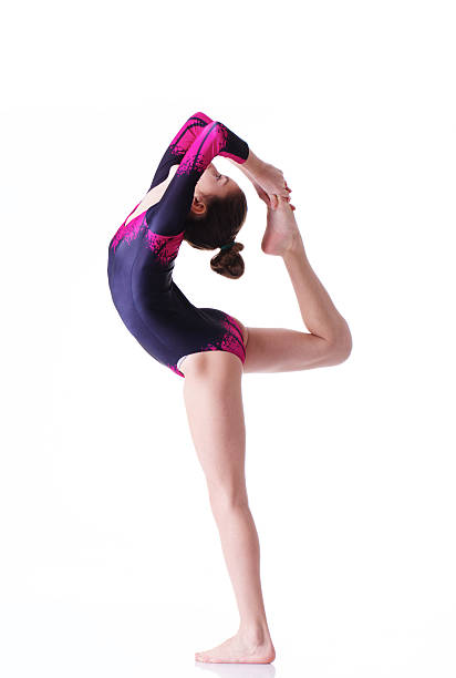 Young female gymnast performing stock photo
