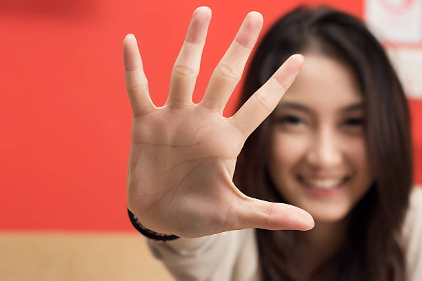 Young female hand show five fingers. stock photo