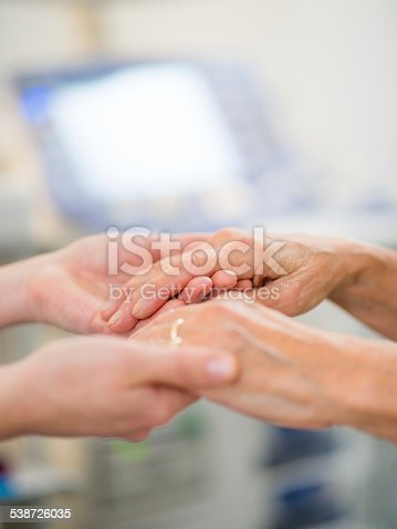 667827758 istock photo Young Female Hands Holding a Senior Woman's Hands 538726035