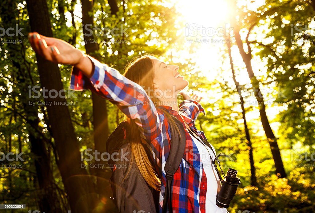 Young female hiker in forest. stock photo