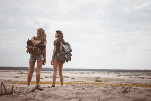Young Female Hikers Looking At Desert Landscape Stock Photo - Download Image Now