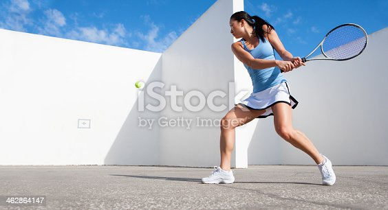 istock young female hitting tennis ball against a wall 462864147