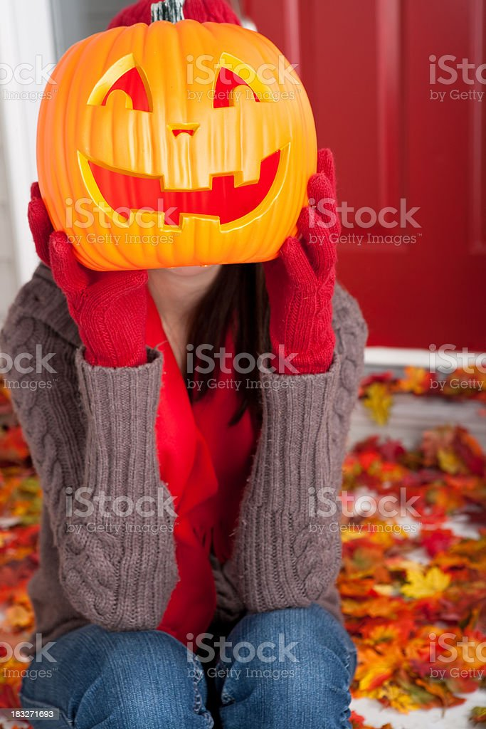 Young female holding a jack o lantern royalty-free stock photo