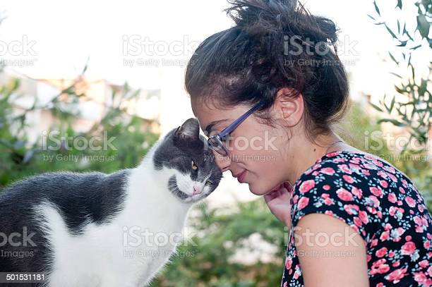 Young female holding her loving cat picture id501531181?b=1&k=6&m=501531181&s=612x612&h=rk5sj4au ur2b8togsxoj7mkddstxafh6gcniuspx00=