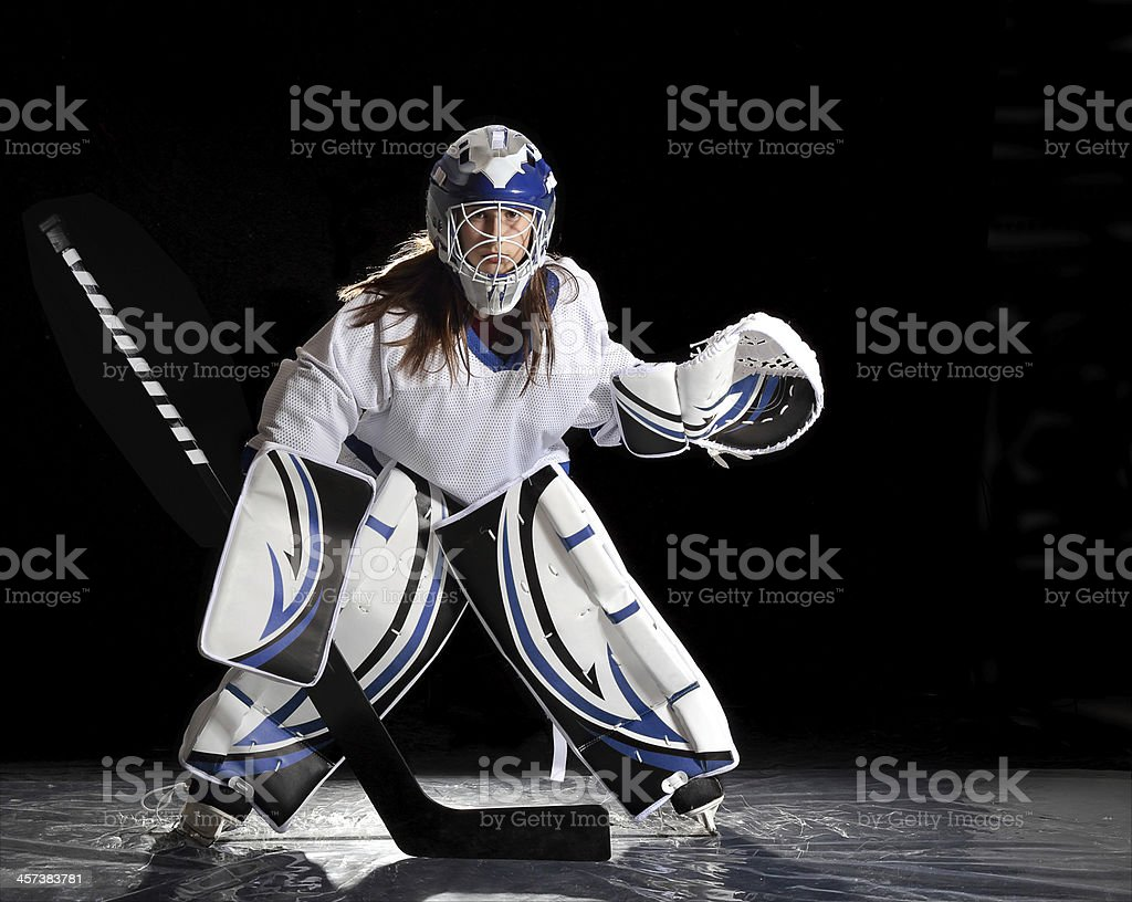 Young Female Ice Hockey Goalie In White Jersey Stock Photo More