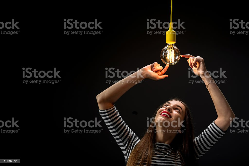 Young Female Inventor With Illuminated Lamp Stock Photo Download