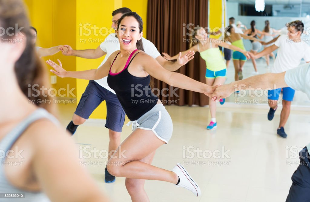 Young female is dancing rock-n-roll with partner stock photo