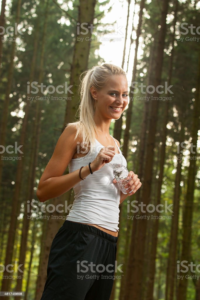 young female jogger stock photo