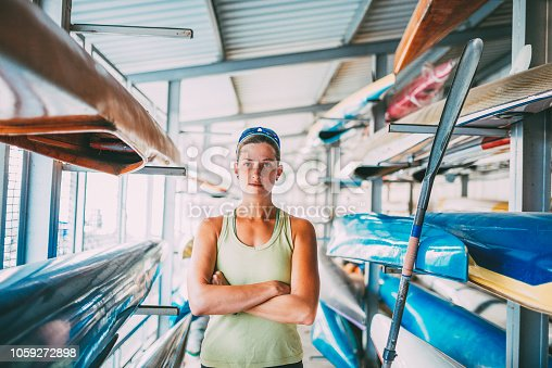 istock Young female kayaker choosing paddle 1059272898