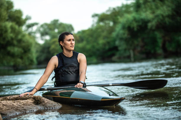 Young female kayaker on river stock photo