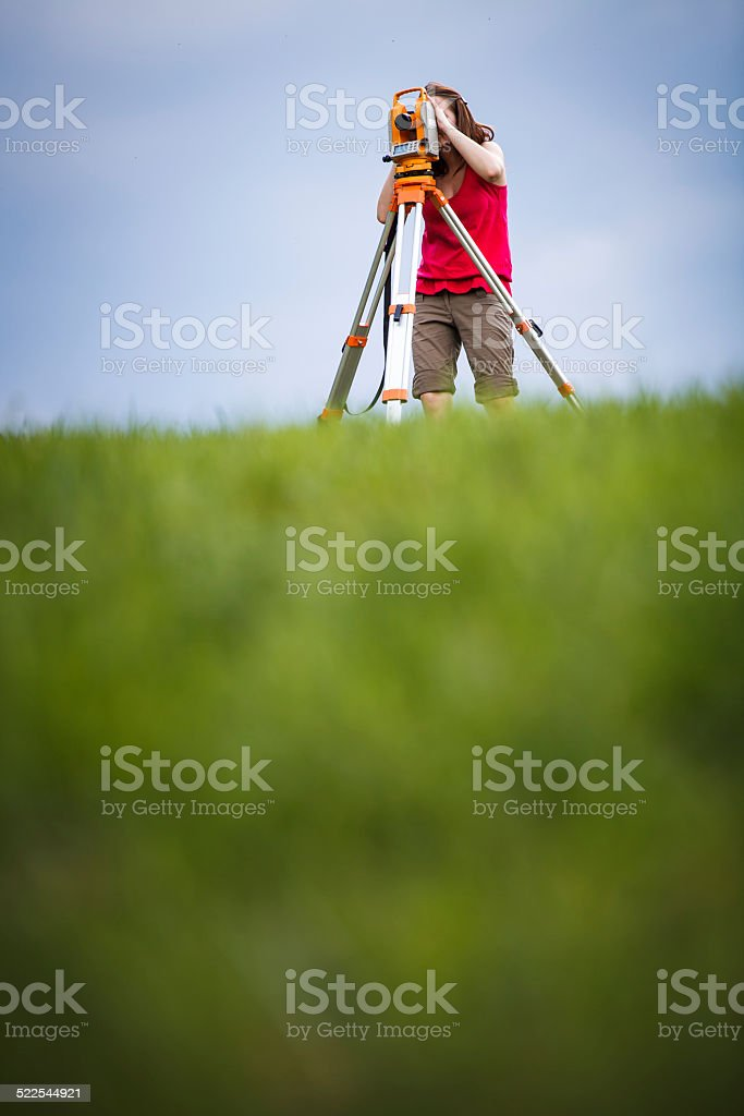 Young, female land surveyor at work stock photo
