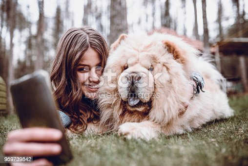 636418612 istock photo Young Female Making Selfie with her Chow Chow Dog in Park 959739842