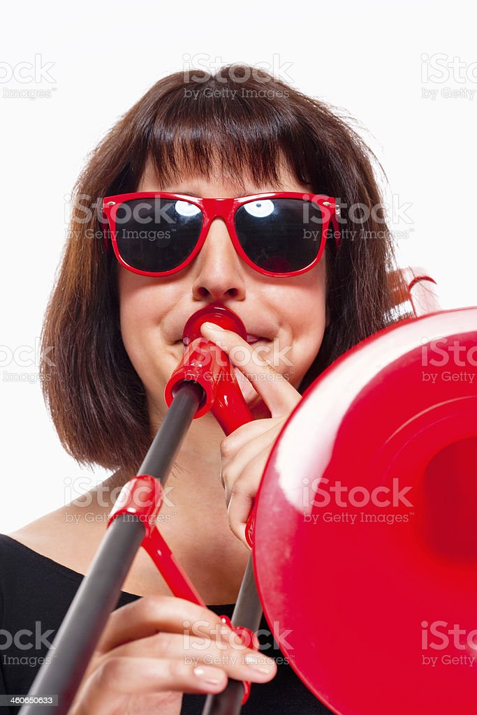 Young Female Musician Playing Trombone royalty-free stock photo