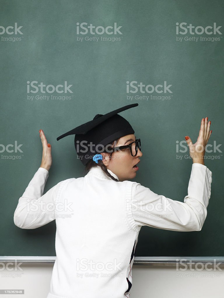 Young female nerd in front of the blackboard royalty-free stock photo