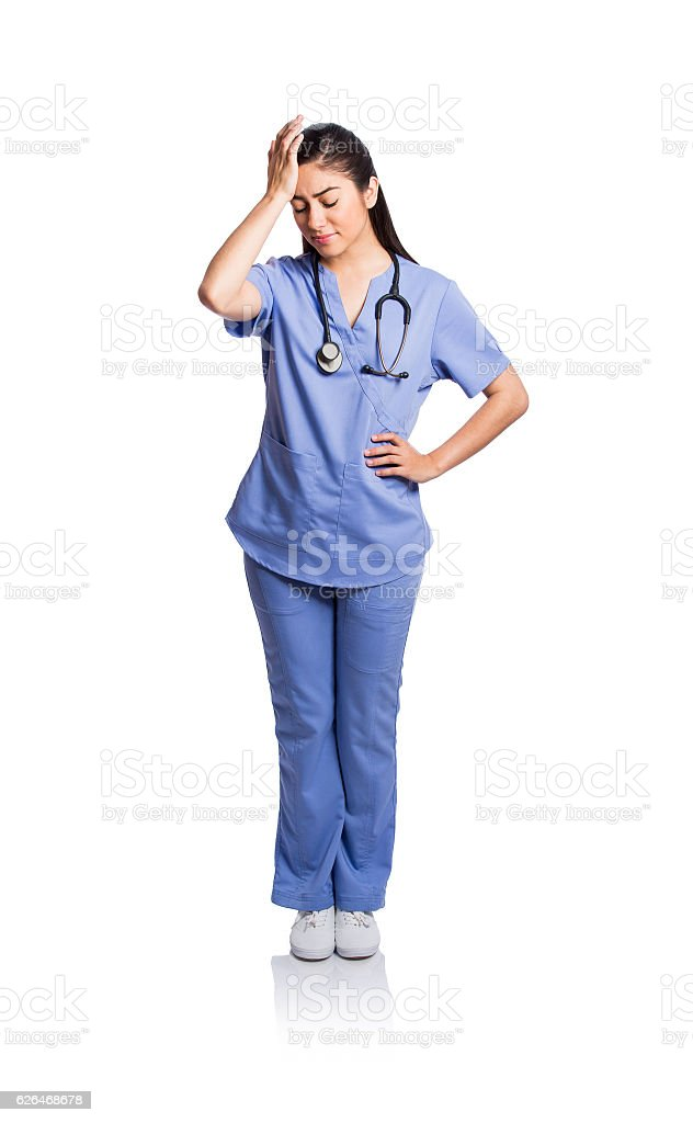 Young female nurse standing in distress stock photo