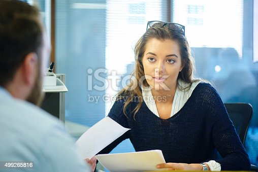 istock young female office worker chatting to a colleague 499265816