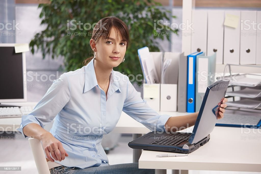 Young female office worker working royalty-free stock photo