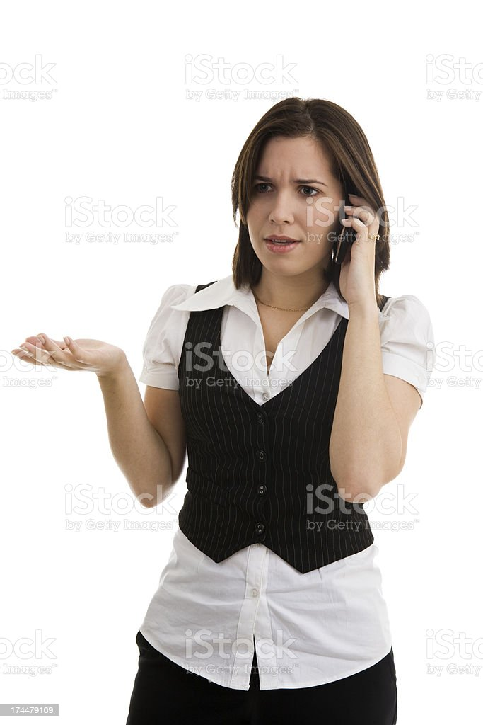Young female on cellphone gesturing and making a concerned face royalty-free stock photo