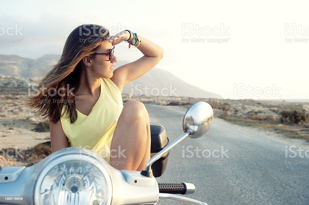 Young female on motorcycle trip royalty-free stock photo