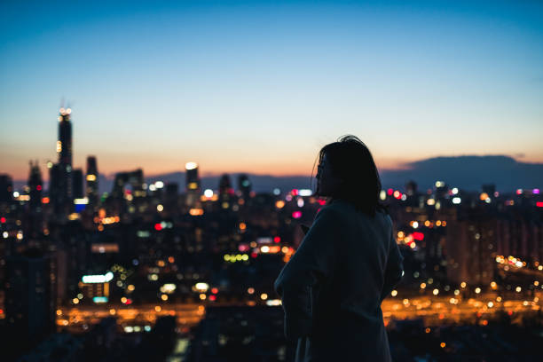 Young Female Overlooking the Stunning View Of City stock photo
