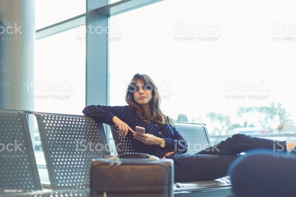 Young female passenger waiting for her flight stock photo