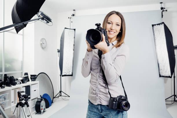 Young female photographer in the studio picture id916459136?b=1&k=6&m=916459136&s=612x612&w=0&h=7s8psvrhkgrlnjfv9pkkvi2ooy99auryndtmkwfzsjm=