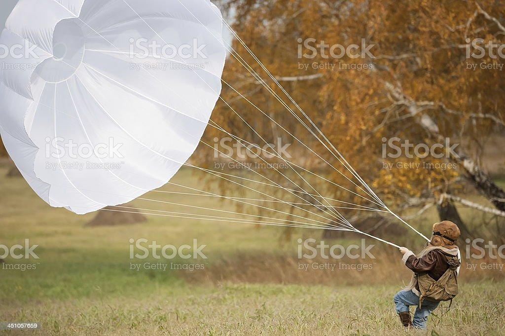 Young female pilot parachute stock photo