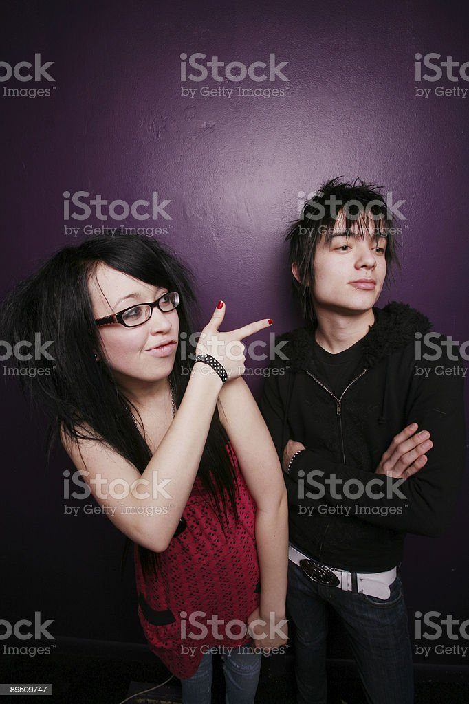 Young Female Pointing at Her Friend Portrait 免版稅 stock photo