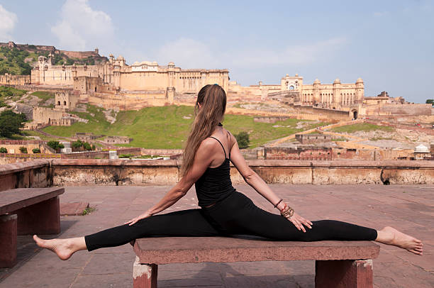 young female practising yoga monkey pose  or hanumanasana - mahroch stock pictures, royalty-free photos & images